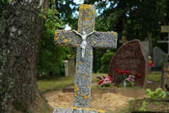 Concrete cross with a crucifix. In the cemetery stock images