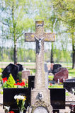 Concrete cross with crucifix in cemetery in summer. Concrete old cross with crucifix in cemetery in summer stock photo