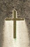 Concrete cross. Green concrete cross on a stone royalty free stock photos