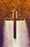 Concrete cross. On a stone with a gradient colors royalty free stock image