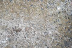 Concrete and crushed stone wall texture. Old wal stock photo