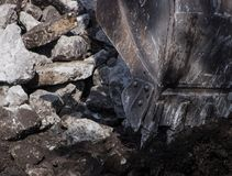 Concrete Crushing Operation III. Piles of concrete construction debris are recycled into crushed concrete for site foundation construction Stock Photo