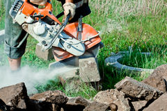 Concrete Curb Cutting. The curb cutting saw works with petrol driven angle grinder Royalty Free Stock Photo