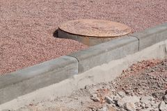 Concrete curb on new building site. Roadwork. Royalty Free Stock Photo