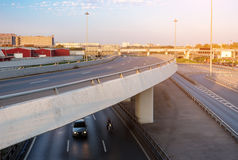 Concrete curved overpass. Overpass with car and motorbike underneath Royalty Free Stock Images