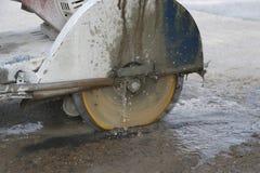 Concrete cutting machine are cutting concrete floor stock photo