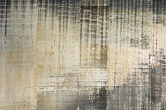 Concrete Dam Face. Concrete arch dam face showing water staining and form patterns Stock Photos