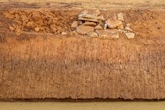 Concrete debris with soil, coastal canal royalty free stock photography