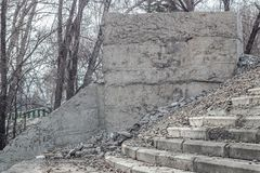 The thrown concrete design with steps. The concrete design and steps is exposed to destruction and fall in the open air Royalty Free Stock Image