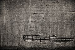 Concrete Wall with Rebar. Concrete devastated wall with visible rebar royalty free stock images