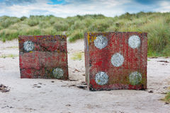 Concrete dice on foreshore near Bamburgh England Royalty Free Stock Photography
