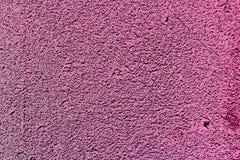 Concrete die muurtextuur in roze kleur wordt geschilderd abstracte achtergrond Royalty-vrije Stock Afbeeldingen