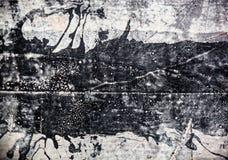 Concrete die oppervlakte met zwarte koolteer wordt bevlekt royalty-vrije stock foto's