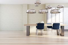 Concrete dining room. Concrete wall dining room with a wooden floor, and a panoramic window. A long wooden table with blue chairs. 3d rendering mock up Royalty Free Stock Image