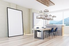 Concrete dining room corner, poster, bar. Concrete dining room with a wooden floor, a large window, white countertops and a panoramic window. A long wooden table Royalty Free Stock Photography