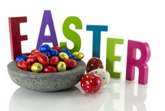 Concrete dish with easter eggs Stock Photography
