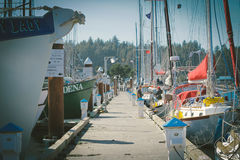 Concrete Dock in Between Boats during Daytime Royalty Free Stock Photo