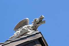 Concrete Dragon Gargoyle on Church Roof Royalty Free Stock Image