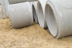 Concrete drainage pipe on a construction site Stock Images