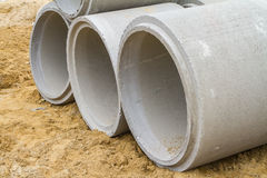 Concrete drainage pipe on a construction site Stock Photos
