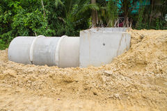 Concrete drainage pipe and manhole under construction Royalty Free Stock Photo