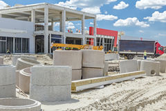 Concrete drainage pipes are on a construction site ready to be p Stock Image