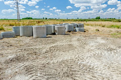 Concrete drainage pipes are on a construction site ready to be p Royalty Free Stock Image