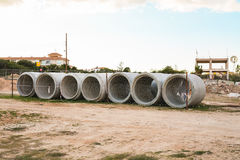 Concrete drainage pipes for industrial building construction. Stock Image