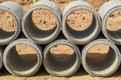 Concrete drainage pipes stacked Stock Photos