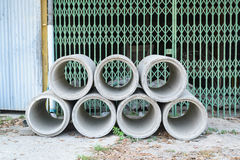Concrete drainage pipes stacked for construction, irrigation, in Royalty Free Stock Images