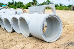 Concrete drainage pipes stacked for construction, irrigation, in Stock Images