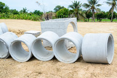 Concrete drainage pipes stacked for construction, irrigation, in Stock Photos