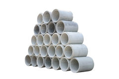 Concrete drainage pipes stacked for construction, irrigation, in Royalty Free Stock Photo