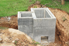 Concrete drainage tank Stock Images