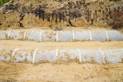 Concrete drainage tube on construction site Stock Image
