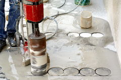 Concrete drilling. Industrial concrete drilling on floor Stock Photo