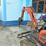 Concrete drilling machine around the building royalty free stock photo