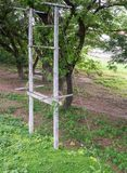 Concrete electric pole with the sling wire. Stock Image