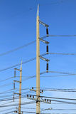 Concrete electricity post on blue sky background Royalty Free Stock Image