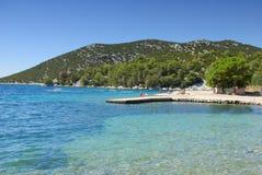 Concrete empty beach in the bay of turquoise sea, Croatia Stock Photo