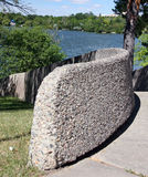 Concrete fence. Exposed aggregate Concrete Fence at a park royalty free stock photo