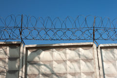 Concrete fence with barbed wire Stock Photography