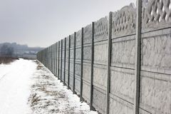 Concrete fence. Winter. stock photo