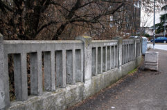 Concrete fences surrounded by trees. On the Varadin Bridge, Novi Sad, Serbia Royalty Free Stock Images