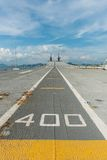 Concrete fighter jet run way of an aircraft carrier Stock Photos