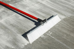 Concrete finishing broom with plastic bristles and red handle Stock Images