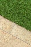 Concrete Floor and Green Artificial Grass landscaping design Royalty Free Stock Photos
