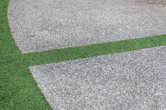 Concrete floor and green grass Royalty Free Stock Photography