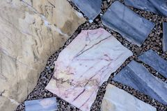 Concrete floor with multi-colored marble stone slabs background and texture.  royalty free stock photography