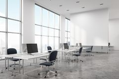 Concrete floor open space office corner. Concrete floor office interior with white walls and computer desks. Panoramic windows and a screen. A corner. 3d royalty free stock photo